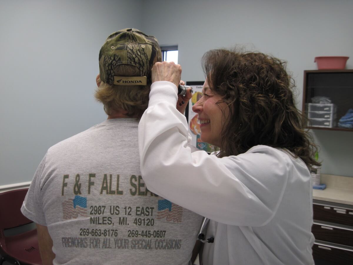 Patient receiving an ear exam.